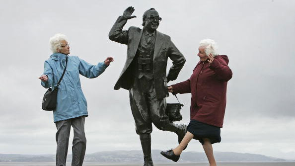 despite inclement weather pensioners raise a happy smile as they perform the famously british dance of