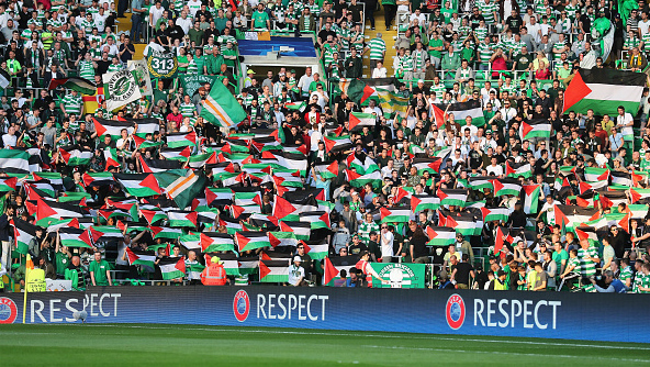 7e7e3918ba0cc Palestinian flags are waved by fans during a UEFA Champions League match  between Celtic and Hapoel