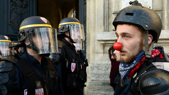 c6e24aea42c6 French riot police officers face a protester of La Nuit Debout