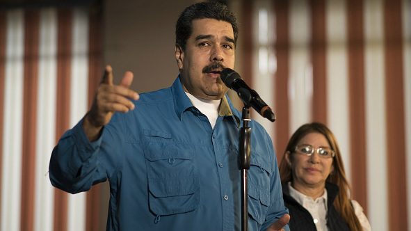 Nicolas Maduro, Venezuela's president, left address members of the media in Caracas, Venezuela, on February 4, 2018.