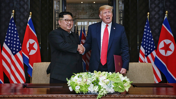 North Korean leader Kim Jong-un shakes hands with U.S. President Donald Trump after signing their joint agreement.