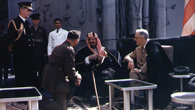 King Ibn Saud converses with President Franklin D. Roosevelt