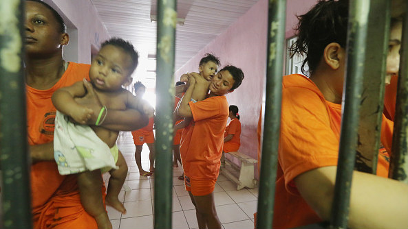 Female inmates gather with babies as they greet visitors in the Pedrinhas Prison Complex, the largest penitentiary in Maranhao state, on January 27, 2015, in Sao Luis, Brazil.