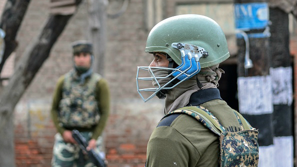 An Indian paramilitary trooper stationed in Srinagar during the third consecutive day of the curfew on April 4, 2018.