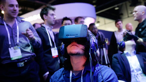 Attendees play a video game wearing Oculus Rift virtual reality headsets at the International Consumer Electronics Show