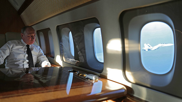 Russian President Vladimir Putin aboard an airplane on his way to the Russian Hmeimim airbase in western Syria on December 11, 2017.