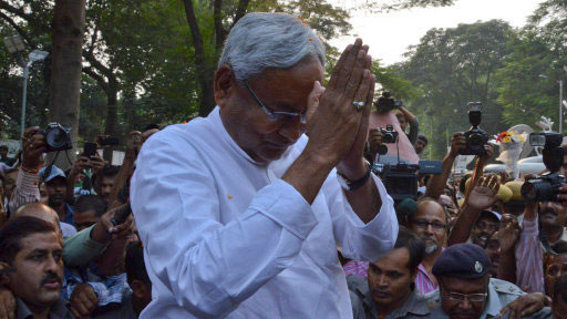 Bihar Chief Minister Nitish Kumar greets supporters in Patna on Sunday