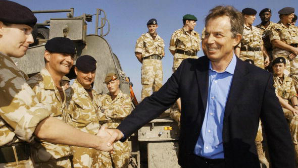 The Chilcot report heavily criticised Tony Blair (R), here seen visiting British troops in Basra on January 4, 2004