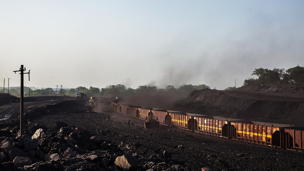 8d721e0fbb Loaders fill railcar wagons with coal at a depot, operated by Coal India  Ltd.
