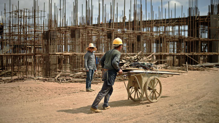 Chinese workers working on railway infrastructure linking Djibouti and Ethiopia, on May 5, 2015