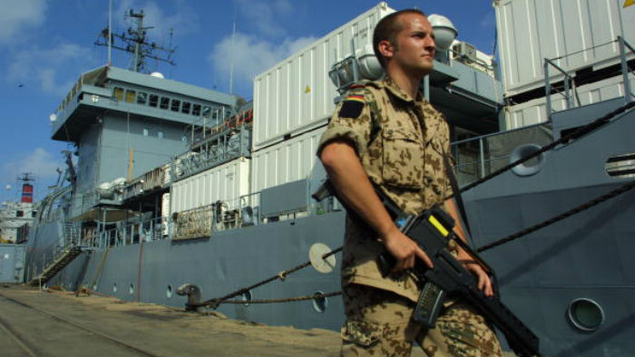 A German soldier guards the German military supply ship Elbe at the port in Djibouti City, on February 21, 2003