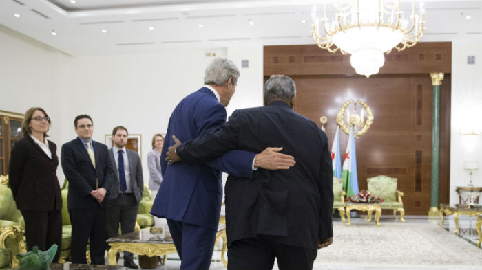US Secretary of State John Kerry and Djibouti's President Ismail Omar Guelleh embrace in Djibouti City, on May 6, 2015