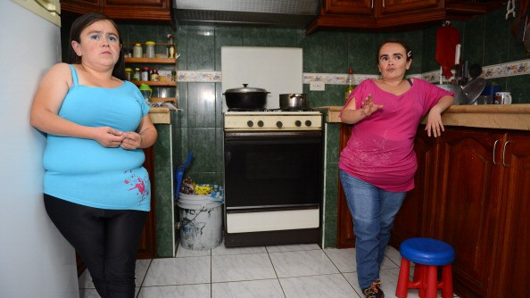 Ecuadorean Maritza Valarezo (L) and her sister Lugartda, both with Laron syndrome, at their house in Quito in 2014