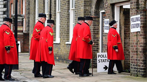 Chelsea pensioners enter a polling station on June 23