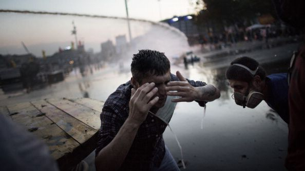 A man reacts in pain to tear gas during the Gezi Park protests in Istanbul in July 2013