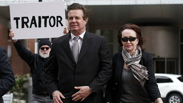 Former Trump campaign manager Paul Manafort (2nd R) arrives for an arraignment hearing in Alexandria, Virginia on March 8, 2018.