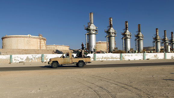 Forces opposed to Libya's unity government ride a truck at the Zueitina oil terminal on September 14, 2016