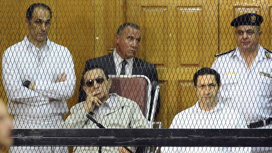 Mossack Fonseca was fined $37,500 for failing to properly check Alaa Mubarak (R), here seen in court with his father and brother