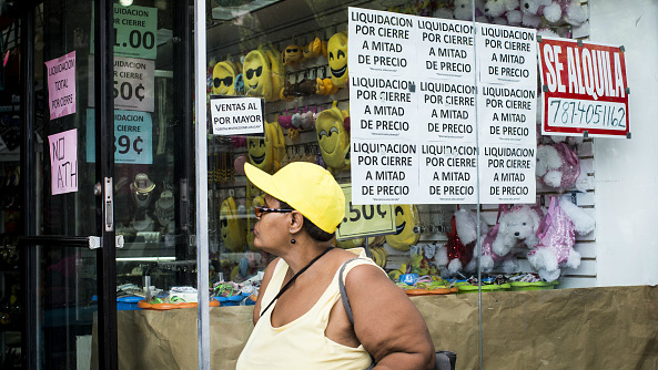 168f8e810b968 A pedestrian walks past a store that is under liquidation in the Rio  Piedras neighbourhood in