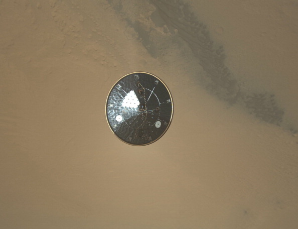 The heat shield of NASA's Curiosity rover during its descent to the surface of Mars