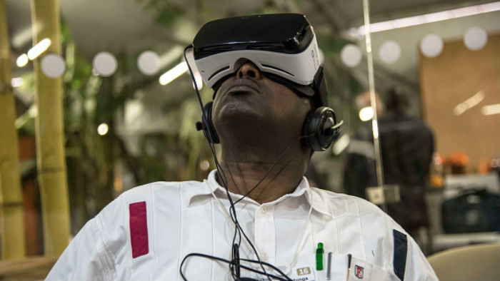 A man enjoying virtual reality at the World Economic Forum on Africa, held in Kigali, Rwanda, on May 12, 2016
