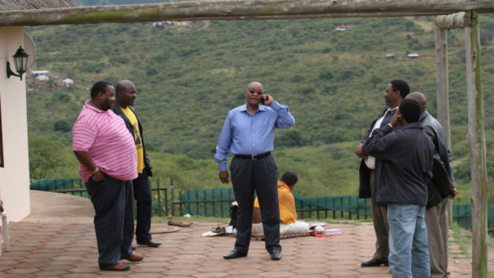 Jacob Zuma and his nephew Khulubuse (in the pink shirt) relax just before the former took office in 2009