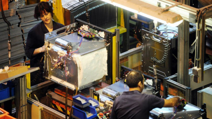 People work on an assembly line at the Mondragon group's Fagor electrical appliances' plant on October 5, 2012