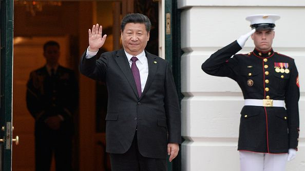 Chinese President Xi Jinping arrives at the White House for a working dinner on March 31