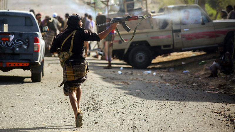 A pro-government fighter is seen during clashes west of the flashpoint city of Taiz